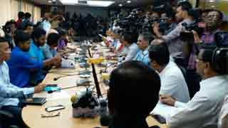 Quader sits with protesters for talks