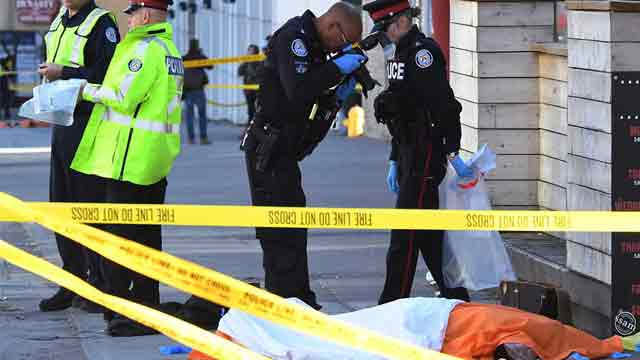 Driver kills 10 plowing van into Toronto sidewalk crowd
