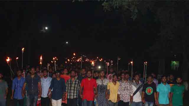 JU marches with torch in protest