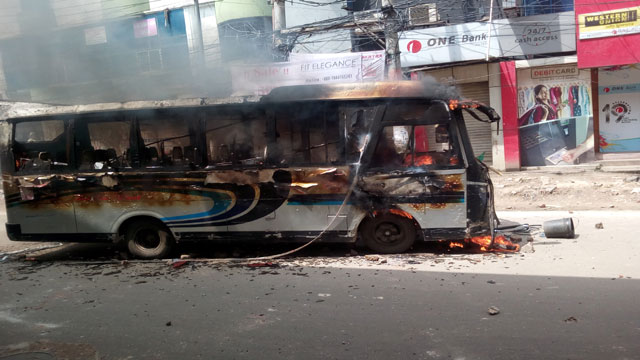 Bus torched after it kills motorcyclist in city