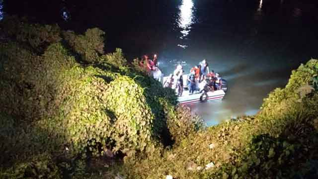 Taxicab plunges into canal in Savar