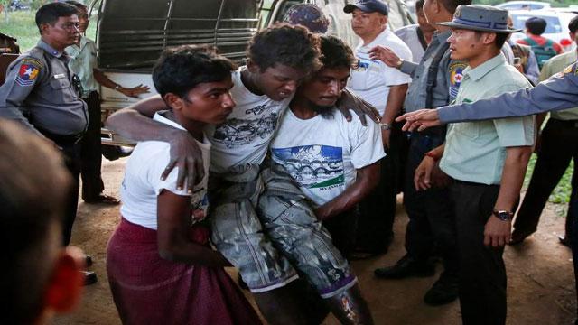 Myanmar police shoot, injure 4 in Rohingya camp raid