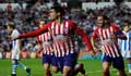 Morata double keeps up 10-man Atletico's Barca chase