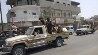 Yemeni government forces push into key port city of Aden