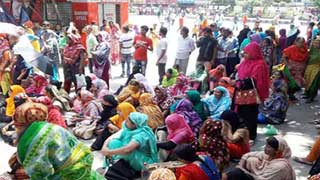 Due wages: Garment workers block Mirpur 1 intersection