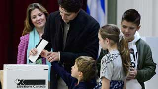 Liberal icon Trudeau appears set to hold onto government