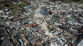 Hurricane death toll in Bahamas at 30 as aid begins to land
