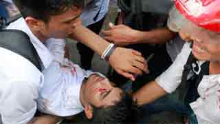 Release photographer and end violent crackdown on student protests