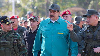 As West turns on him, Venezuela's Maduro flexes military muscle