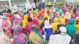 2,000  workers protest inside factory by halting production