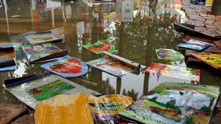 Rain damages stalls, thousands of books at Ekushey book fair
