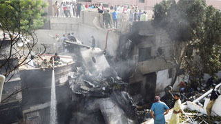 Pakistani plane with 98 on board crashes on homes in Karachi