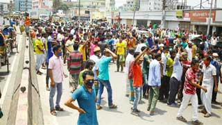 Workers rally at Gabtoli seeking lift of ban on public transports