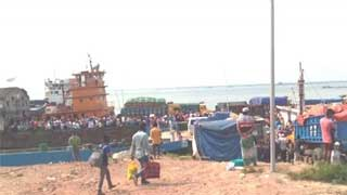 Home-bound passengers crowd Shimulia ferry point