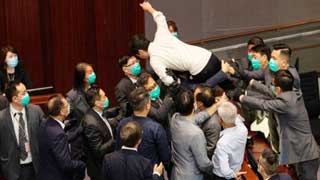Hong Kong: Lawmakers carried out during parliament mayhem