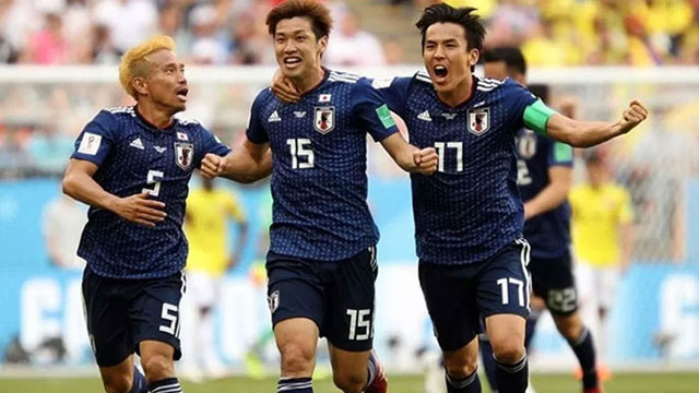 Lucky Japan qualify for knockout
