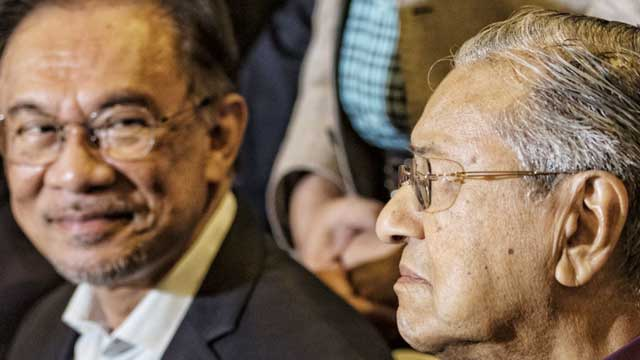 Malaysia's Mahathir resigns but is asked to stay as interim PM