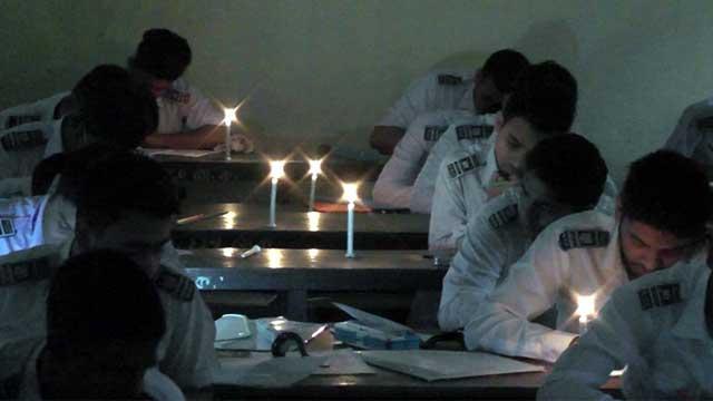 Rangpur HSC examinees take exams under candlelight
