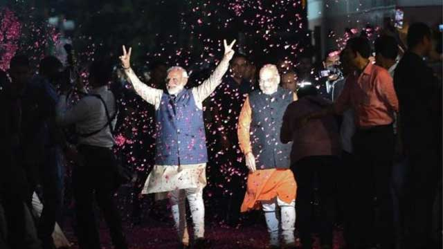 Modi secures landslide win