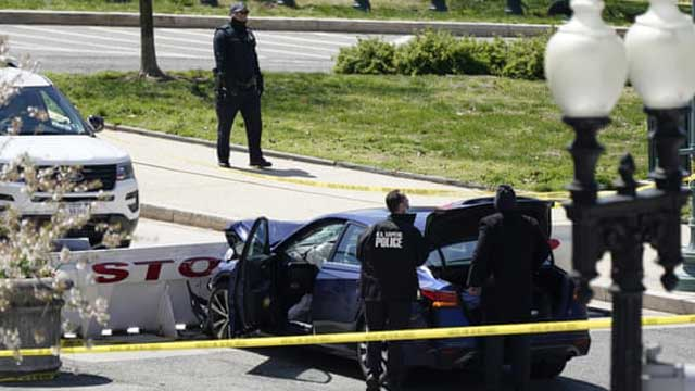 US Capitol lockdown: two officers injured after car rams into barrier