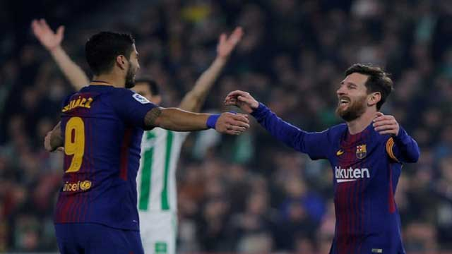 Messi, Suarez score twice as Barcelona extends league lead